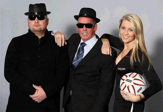 Blues Brothers David Jeffrey and Martin McGaughey with Carling girl Catherine Milligan. Linfield stars from past and present were at Windsor Park last night as the second half of the 'Carling Presents an Evening of Legends' events kicked off. More than 150 blues fans braved the freezing weather to meet their Linfield heroes Peter Rafferty, Martin McGaughey, David Jeffrey and Noel Bailie