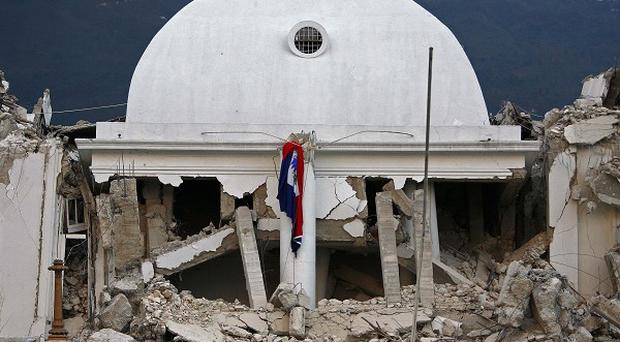 The center dome of Haiti's National Palace is seen collapsed after a 7.0-magnitude earthquake struck Port-au-Prince