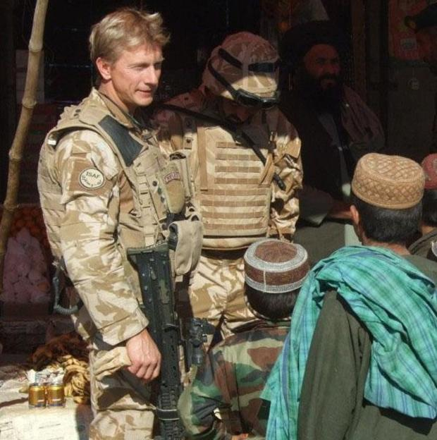 Lt Col Nick Kitson talking to local Afghan people at the Sangin DC Bazaar
