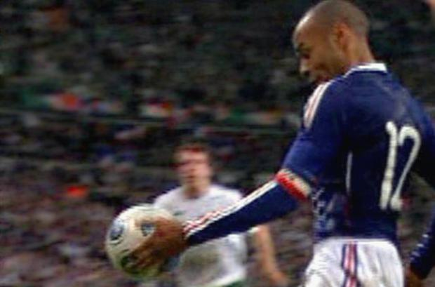 Thierry Henry controls the ball with his hand during the build up to France's goal in Paris