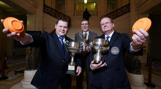 Minister Nelson McCausland (centre) with Ricky Jermy (High Gun trophy winner), left, and Trevor McDonald (team captain) holding cups which they won in the 2009 Olympic Skeet Home International