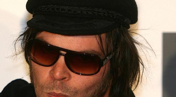Gaz Coombes insists he is still with Supergrass despite his side project