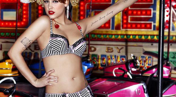 Peaches Geldof posing in the new Miss Ultimo lingerie brand Carousel collection