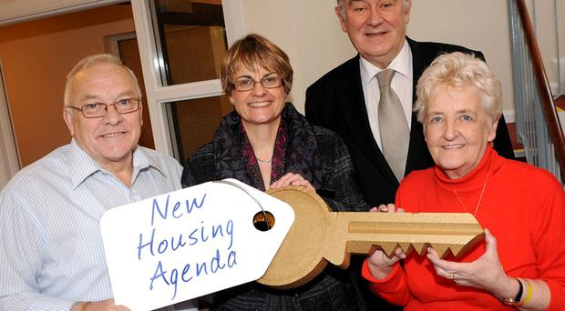 Jim and Eileen Boyd with Minister Margaret Ritchie and Trinity Housing chairman Bill Reilly