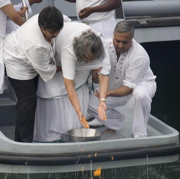 Mahatma Gandhi's grand-daughter Eli Gandhi scatters the ashes of the independence hero (AP)