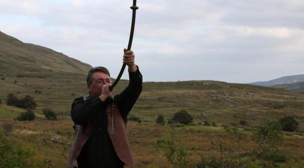 High note — Simon O'Dwyer plays a bronze horn found at Loughnashade, near Navan in Armagh
