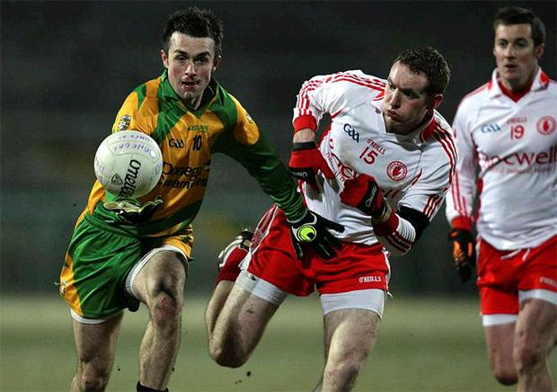 Donegal's David Walsh keeps possession of the ball while under pressure from Tyrone's Aidan Cassidy as the north-west county won the Dr McKenna Cup on Saturday night