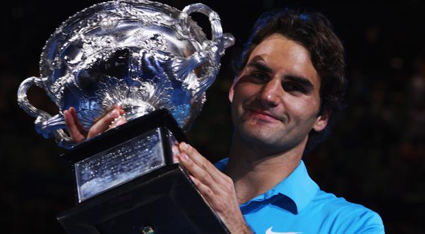 Roger Federer celebrates winning the Australian Open