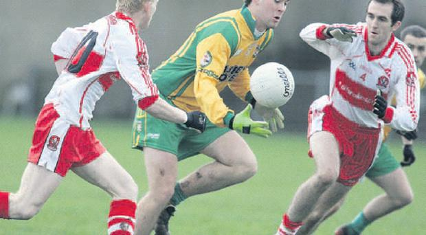 Donegal will be without Eamonn McGee (centre) for Sunday's National League match against Westmeath as he was forced to leave Ireland so that he could find work in London