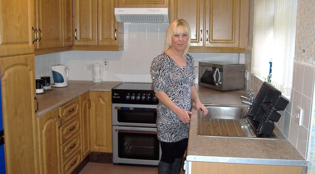 Rathcoole resident Deborah Foster in her new kitchen