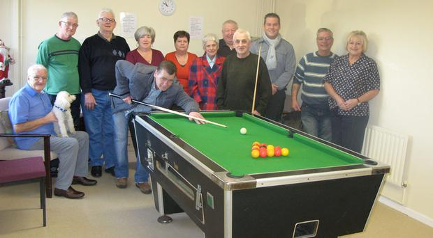 Residents and sponsors gather to celebrate the new hobbies room