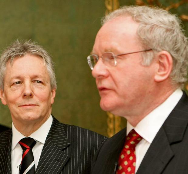 DUP leader Peter Robinson (left) and Sinn Fein's Martin McGuinness during a press conference after a deal was announced about Northern Ireland's power-sharing government.