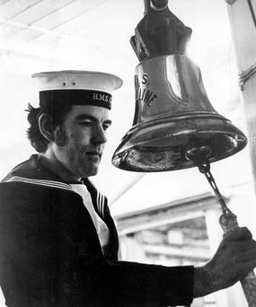 A sailor rings the bell onboard the HMS Caroline. 31/12/1974