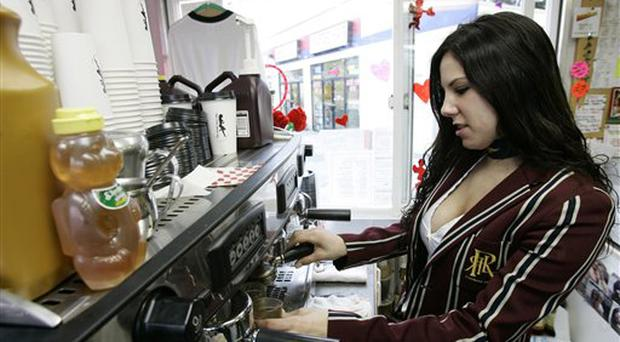 Valerie Stults makes a coffee drink as she works in The Sweet Spot Cafe