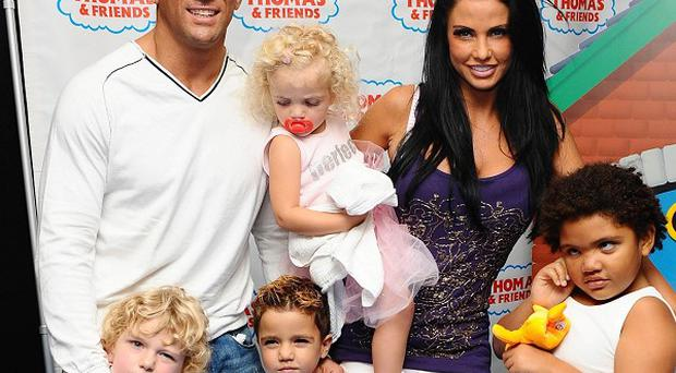 Katie Price and Alex Reid have returned to the UK after marrying in Las Vegas