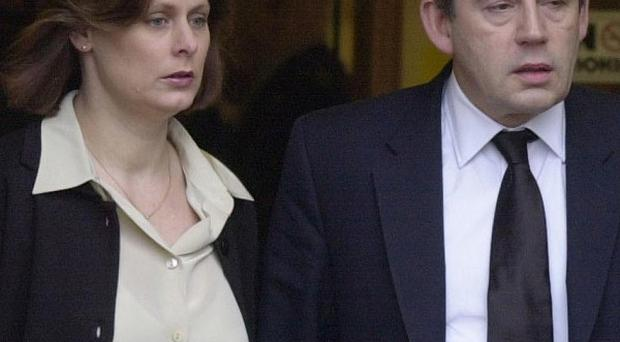 Gordon and Sarah Brown leave the funeral service of their daughter Jennifer in 2002