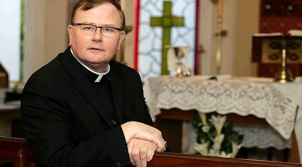 Bishop Pat Buckley in The Oratory at his home in Larne where he was meant tie the knot with his boyfriend yesterday