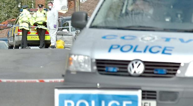 A forensic officer joins police at the scene where Mr Fitzpatrick's beaten body was found