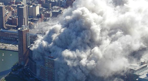 Smoke and ash rise as the World Trade Center tower burns after terrorists flew two airliners into the New York skyscrapers. AP Photo/NYPD, via ABC News, Det. Greg Semendinger