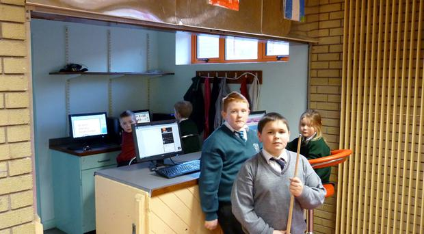 Children from St John Vianney Youth Centre in the Lower Ormeau enjoy the new computer equipment provided through Big Lottery funding