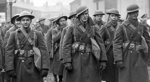 Marching through the streets of Belfast are seen here some of the American troops who were the first of a stream of 300,000 to pass through Northern Ireland. Jan 1942.