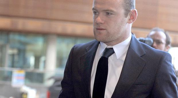 Wayne Rooney arrives at Manchester Mercantile Court yesterday, where he was giving evidence as he battles a £4.3m lawsuit brought by Proactive