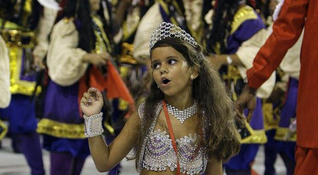 Controversial carnival queen Julia Lira, seven, dances during the celebrations in Rio (AP)