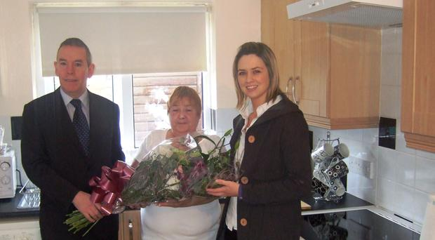 Housing officers Malachy McKinney and Michelle Murphy with Marion Wilson (centre)