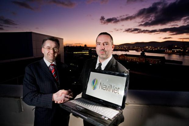 NISP director of corporate real estate, Mervyn Watley, and NaviNet director of Engineering Europe, Damien Dougan, mark the US firm's arrival at the Northern Ireland Science Park.