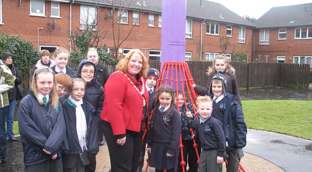 Belfast Lord Mayor, Councillor Naomi Long, with children from the Inverary area who created the new artwork
