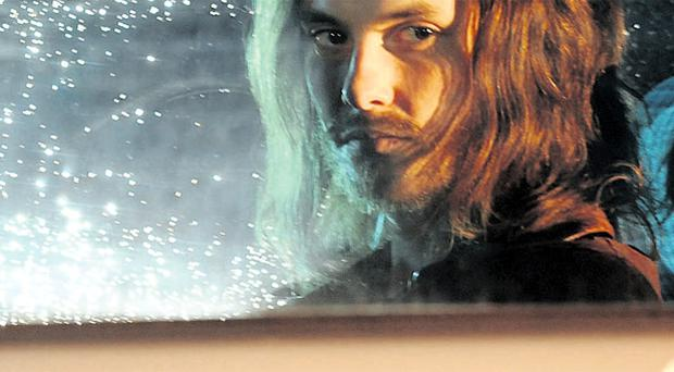 Killing time: Ben Barnes, star of Killing Bono, on set last night in Belfast's Library Street as shooting of the rock comedy draws to an end around the city centre
