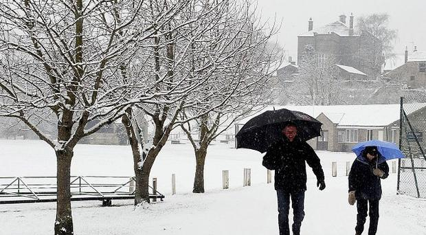 Walkers out and about in Masham near Ripon as snow returned to many parts of the UK
