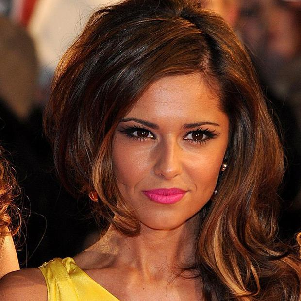 Cheryl Cole sent Ashley Cole a text message to tell him their marriage was over, it has been reported