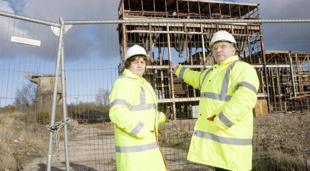 HSENI caught in legal dispute over site work Unhappy customers — Joe Strawbridge of Bridge Line Demolition and Dawn Cairns at the site of the former Courtalds Powerstation in Carrickfergus