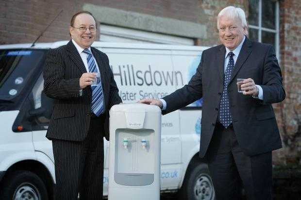 Filling up - Harry Toye (left) and Jack Shirlow of Hillsdown international; the Dunmurray-based company is marketing office water dispensers/purifiers which are the first of their kind in Ireland.