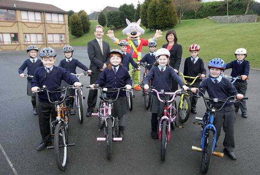 Ronnie Tosh and Nicky Kelly, from Centra, with DOE road safety character Skooter, along with the five sets of twins. L-r front row: Jack and Rachael Barr, Katie and Daniel Robinson. Back row: Naomi and Lucy Perry, Kathryn and Robbie Sinclair and Harry and Josh McIlrath