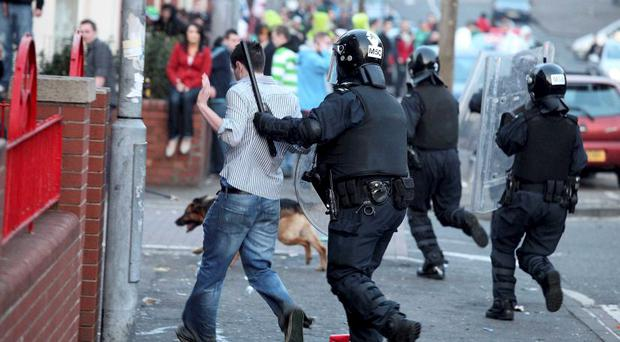 Police attempt to clear the streets of trouble makers when violence erupted in the Holy Land on St Patrick's Day last year, resulting in 12 arrests