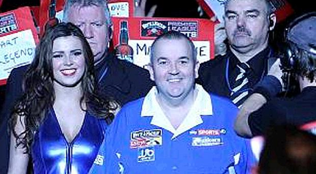 Phil Taylor makes a grand entrance at the Odyssey Arena last night