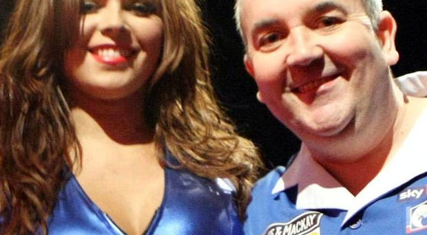 Phil 'The Power' Taylor (and helper) at the 2010 Premier League Darts at Belfast's Odyssey Arena