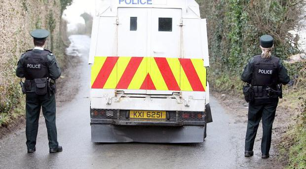 Police seal of the Braehead road in Londonderry near the Irish border