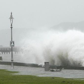 Waves crash against the promenade in North Dublin during the spell of bad weather