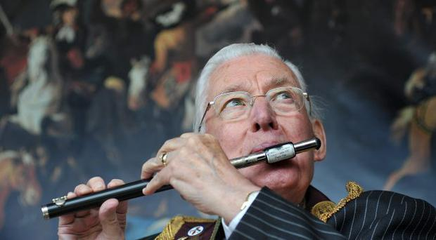 The Rev Ian Paisley plays the flute at the independents Orange parade in Portglenone.2008