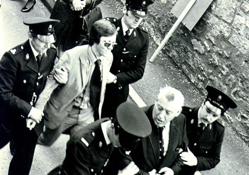 Ian Paisley and Peter Robinson are taken away by police in Armagh after protesting a vist by Charles Haughey in 1980