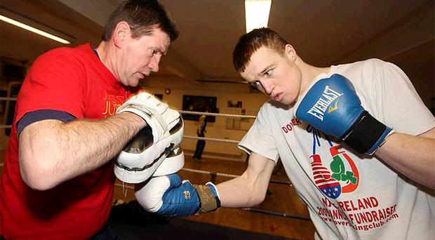 Steven Donnelly prepares to fight for the Irish senior title with coach Gerry Hamill