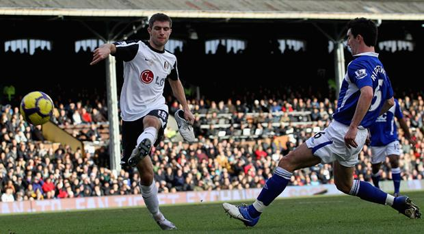 Case for defence: Northern Ireland skipper Aaron Hughes aims to halt Spurs tomorrow