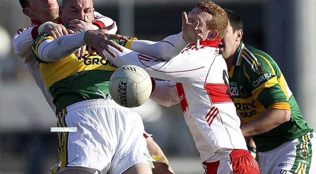 Michael Quirke (left) is outnumbered by Derry duo Patsy Bradley and Fergal Doherty