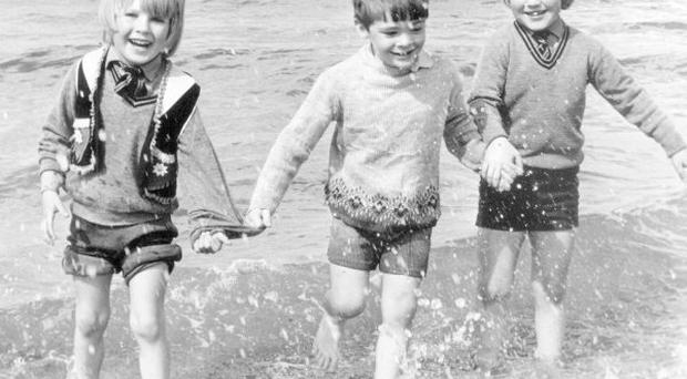 Holywood five-year-olds David Whaley, Adam Green and Stephen Austin couldn't wait to get in for a quick dip at Helen's Bay. But the water was too cold, so they had to settle for a paddle instead. 19/6/1972