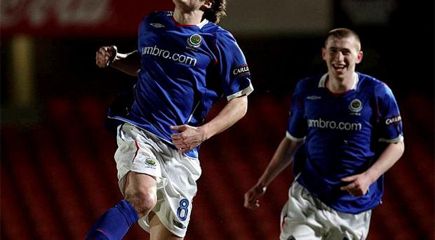 Linfield midfielder Philip Lowry punches the air in delight after scoring at Windsor Park last night where Billy Joe Burns also got on the scoresheet against Dungannon