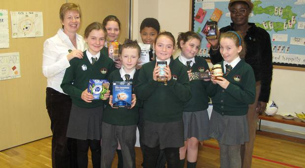 Dundonald co-ordinator for Fairtrade, Gillian Graham and Hella Alikuru show pupils different fair trade products