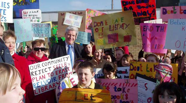 School children, residents and politicians protest outside Belvoir Library